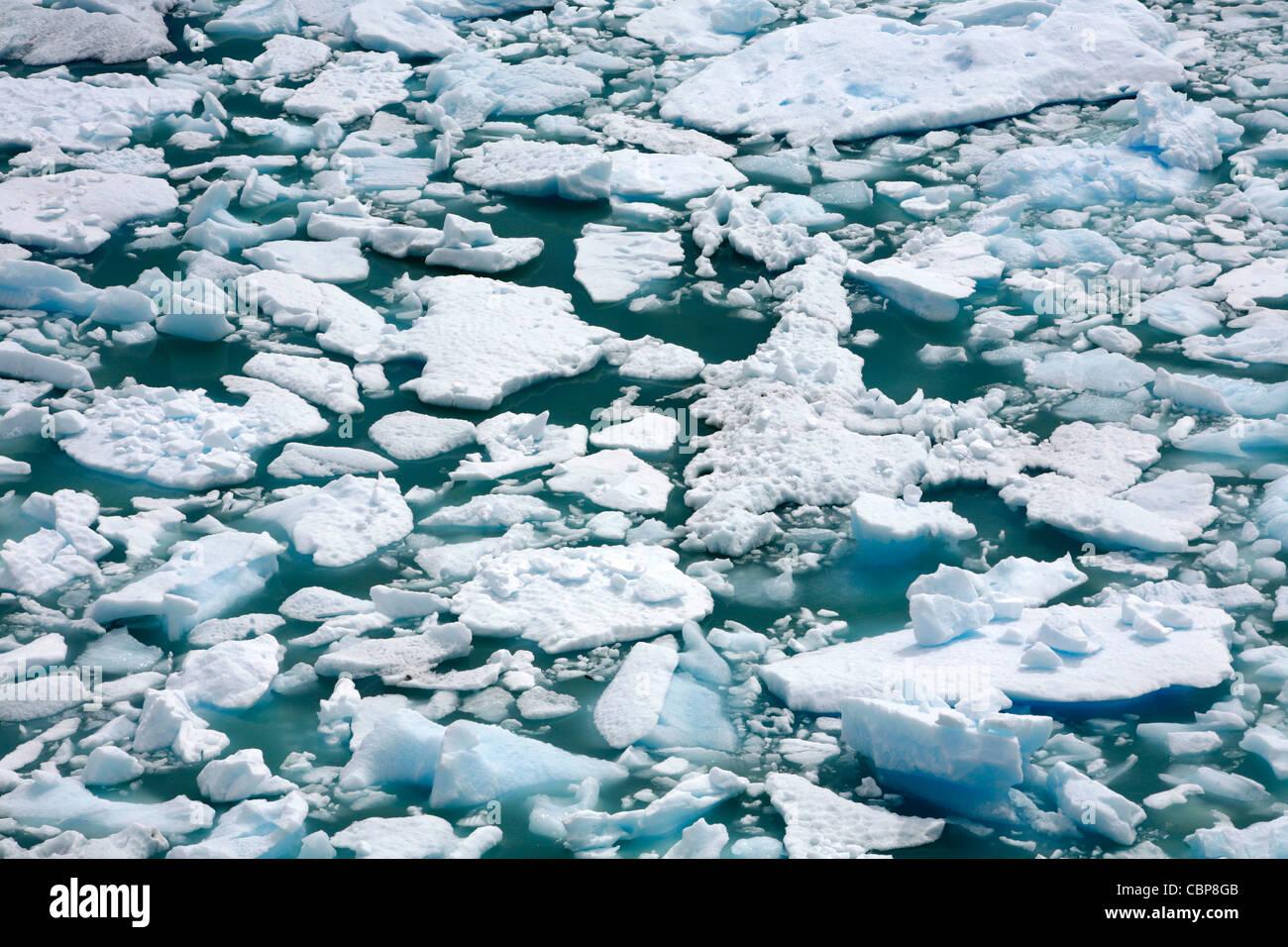Pieces of ice falling off the Perito Moreno glacier. Los Glaciares National Park, El Calafate, Santa Cruz province. - Stock Image