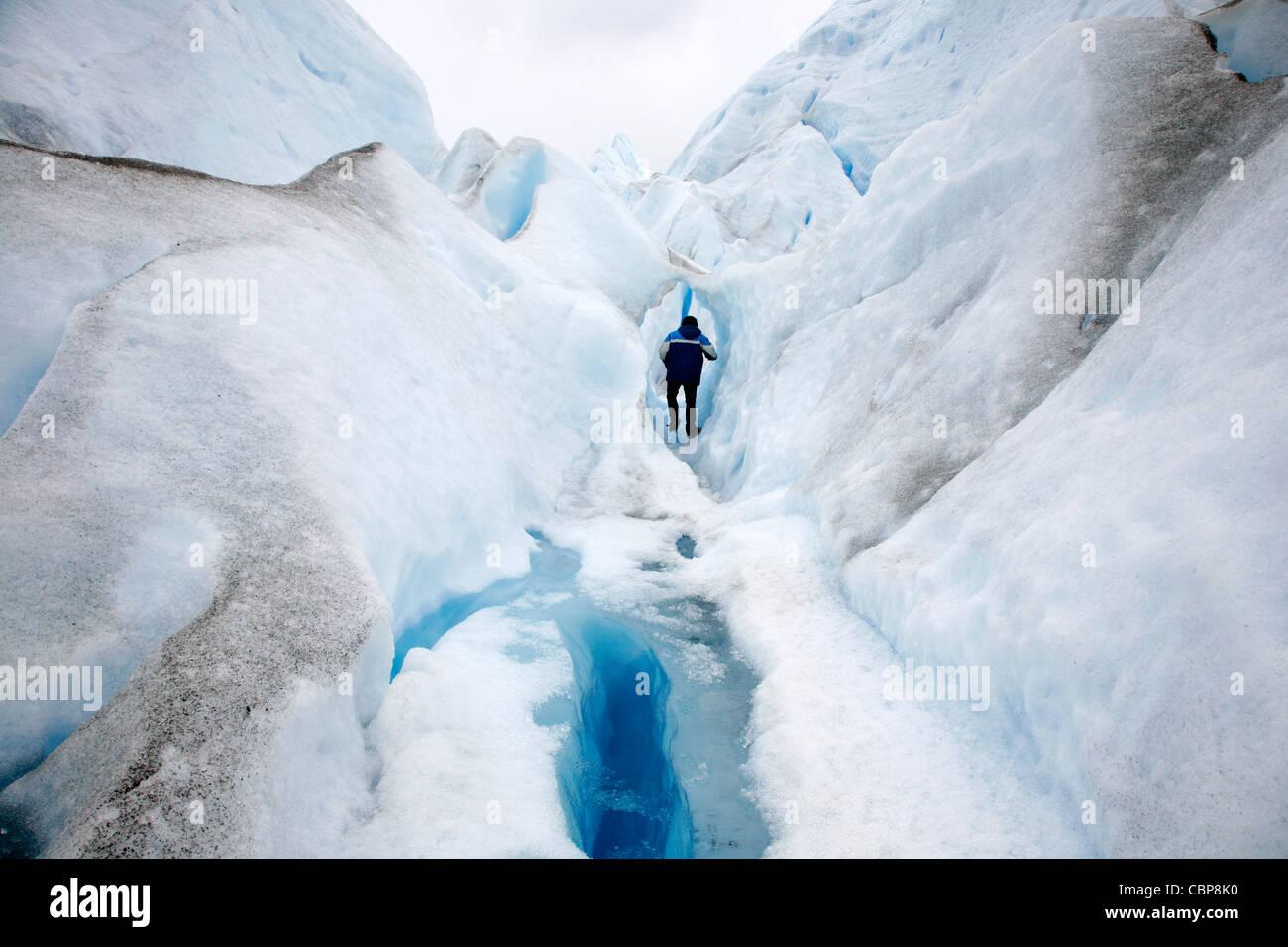 man climbing on Perito Moreno glacier. Los Glaciares National Park, El Calafate, Santa Cruz province. Patagonia. - Stock Image