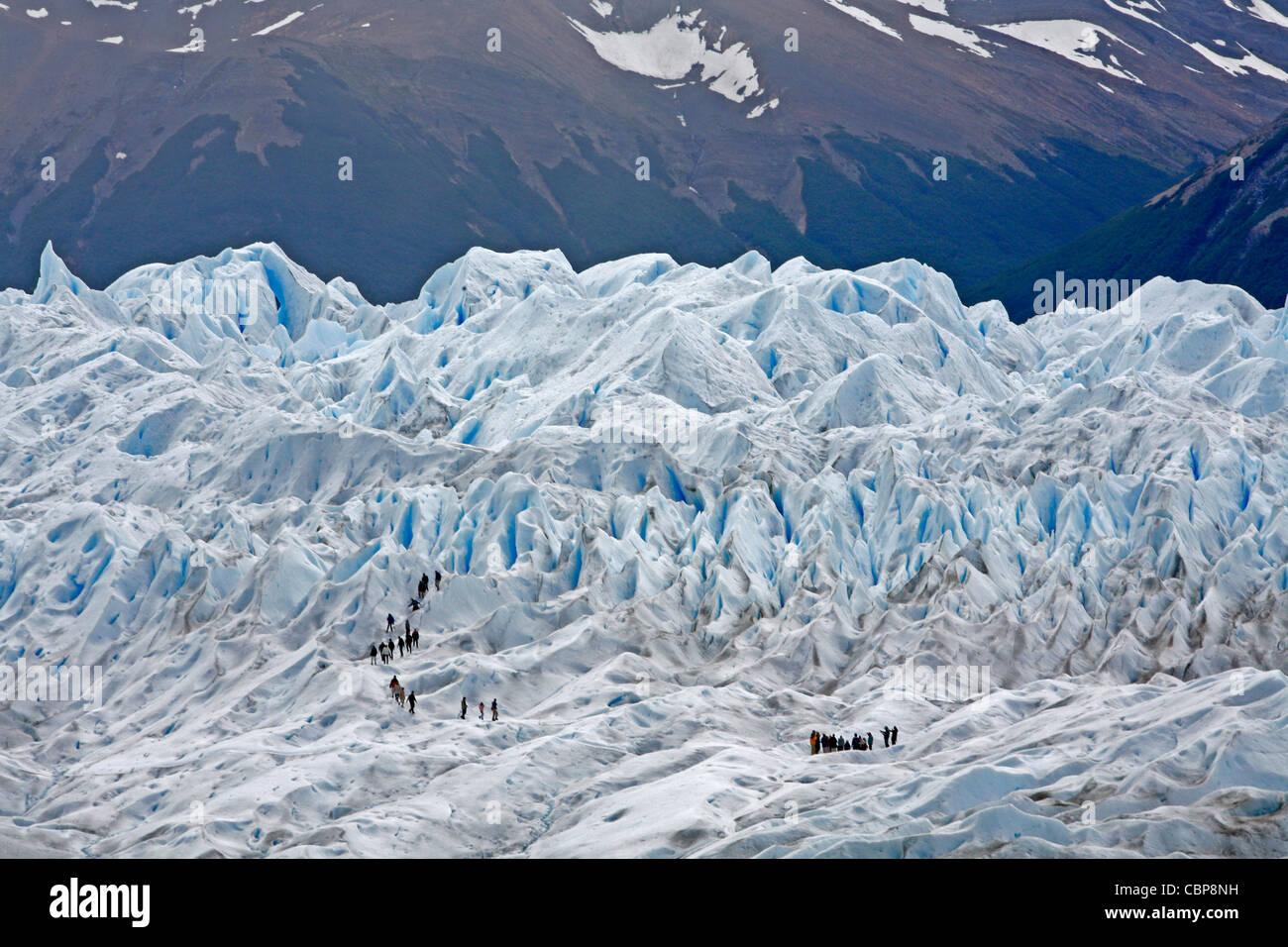 People trekking on Perito Moreno glacier. Los Glaciares National Park, El Calafate, Santa Cruz province. Patagonia. - Stock Image