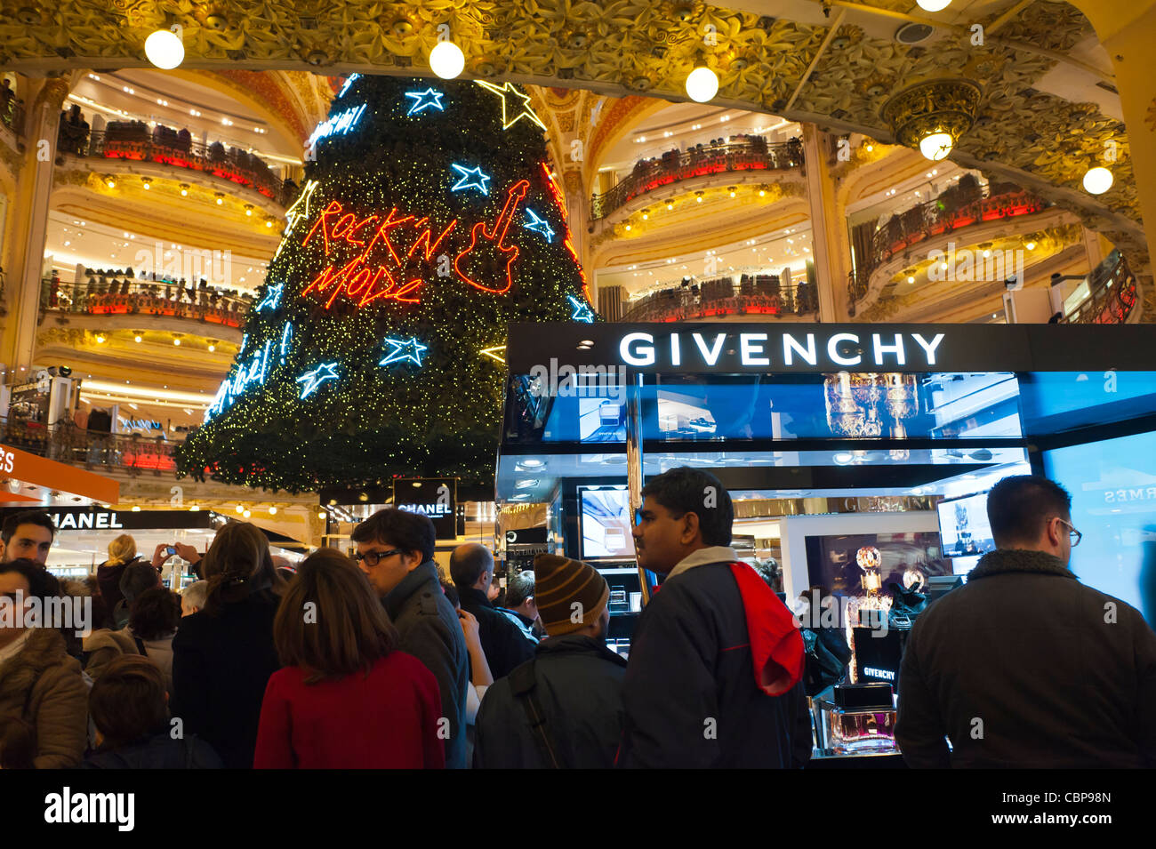 Paris, France, Givenchy Cosmetics Shop, inside Galeries Lafayette Department Store, Crowd of People Enjoying Christmas Decorations, Shopping Stock Photo