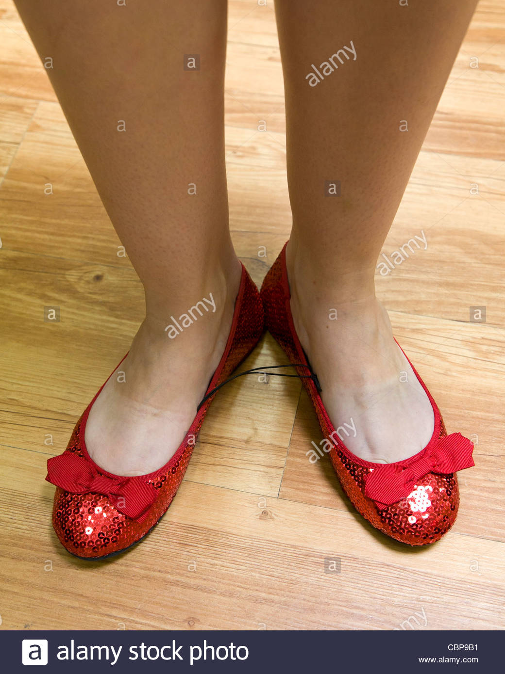 bfb54c13b13 A woman s feet with red ruby slippers Stock Photo  41672261 - Alamy