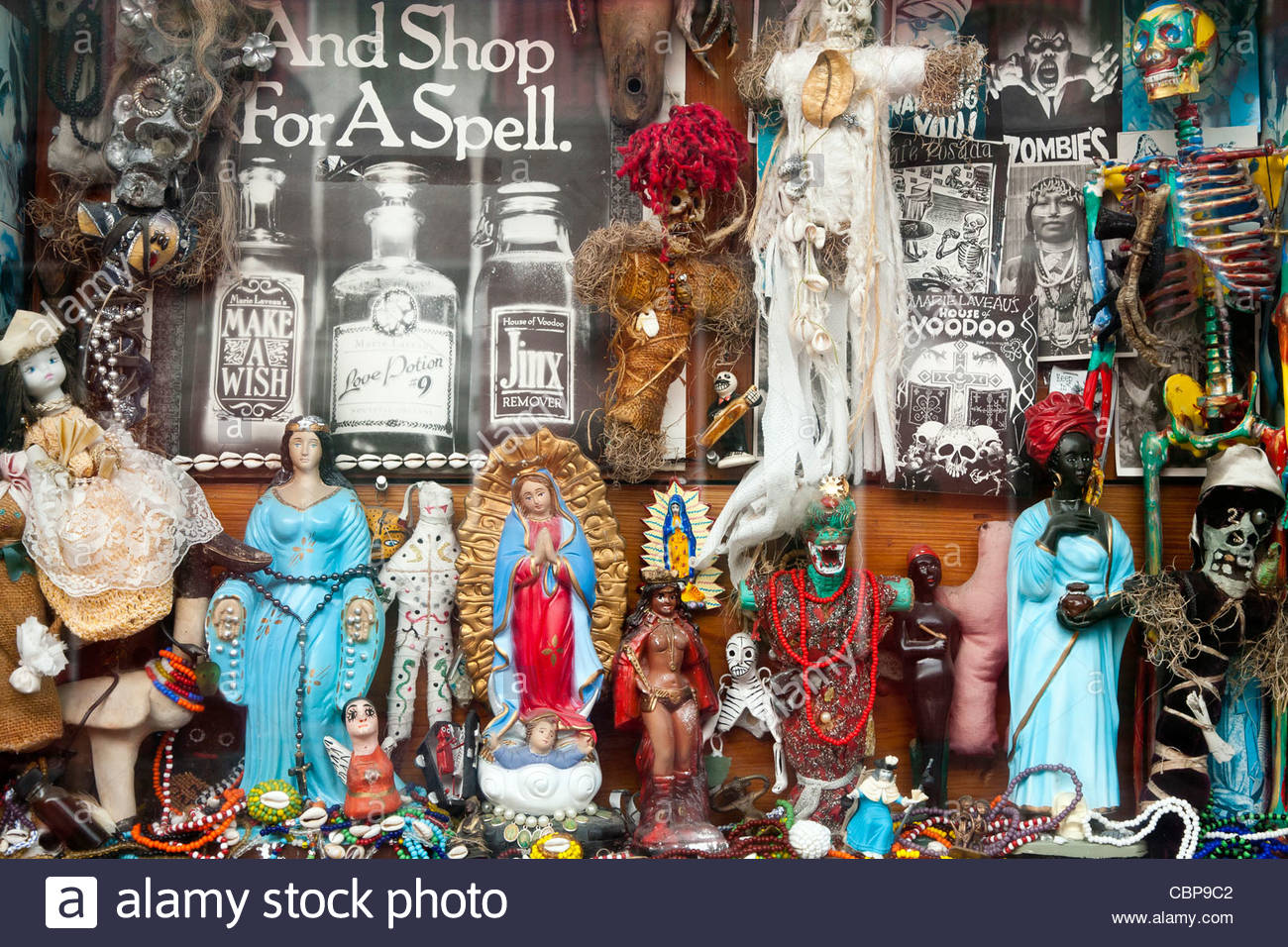 Voodoo dolls and religious symbols in a shop window in the french voodoo dolls and religious symbols in a shop window in the french quarter new orleans louisiana united states buycottarizona Images
