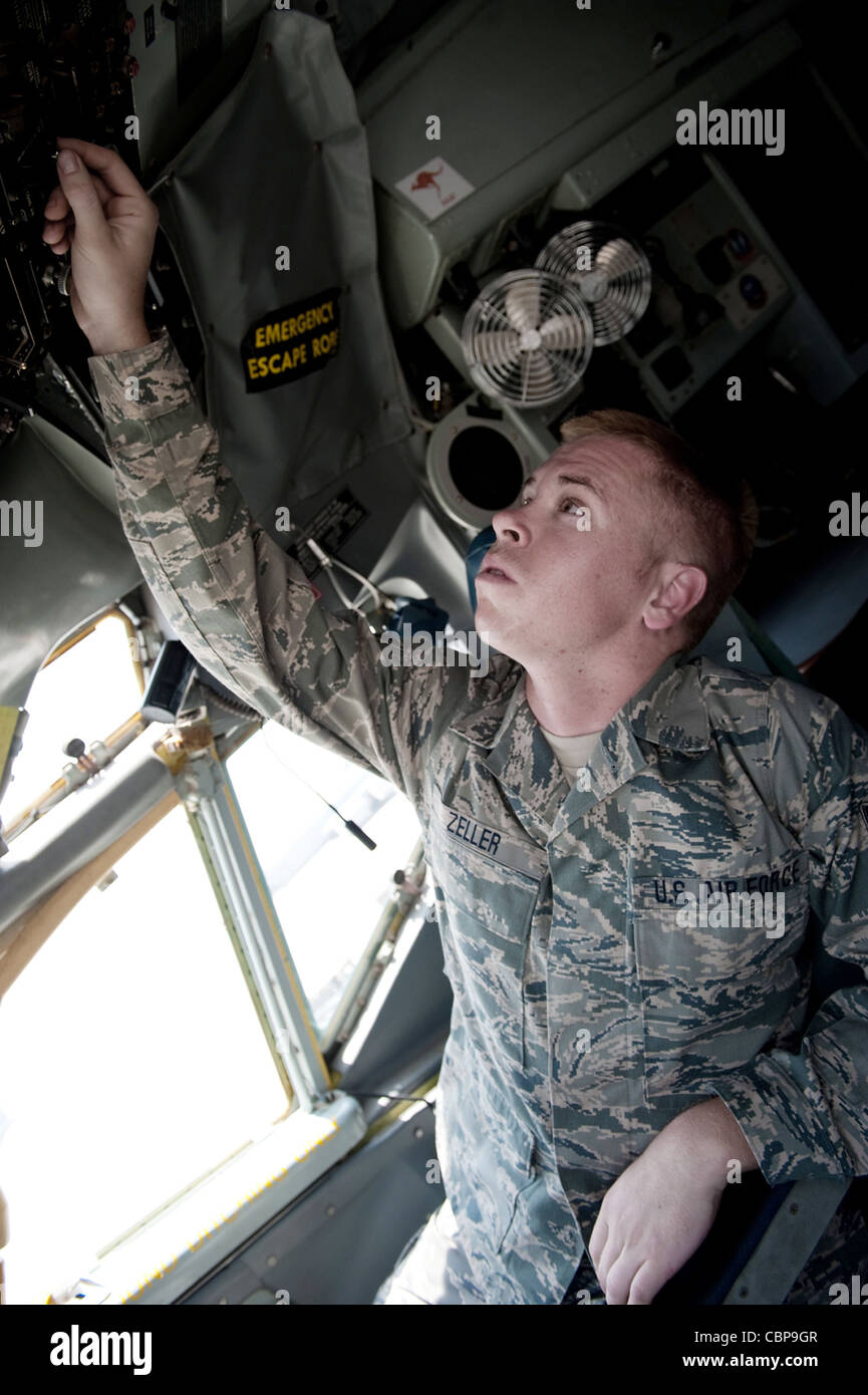 Senior Airman Ryne Zeller performs a preflight check to ensure a KC-135 Stratotanker is safe to fly Aug. 11 at an - Stock Image