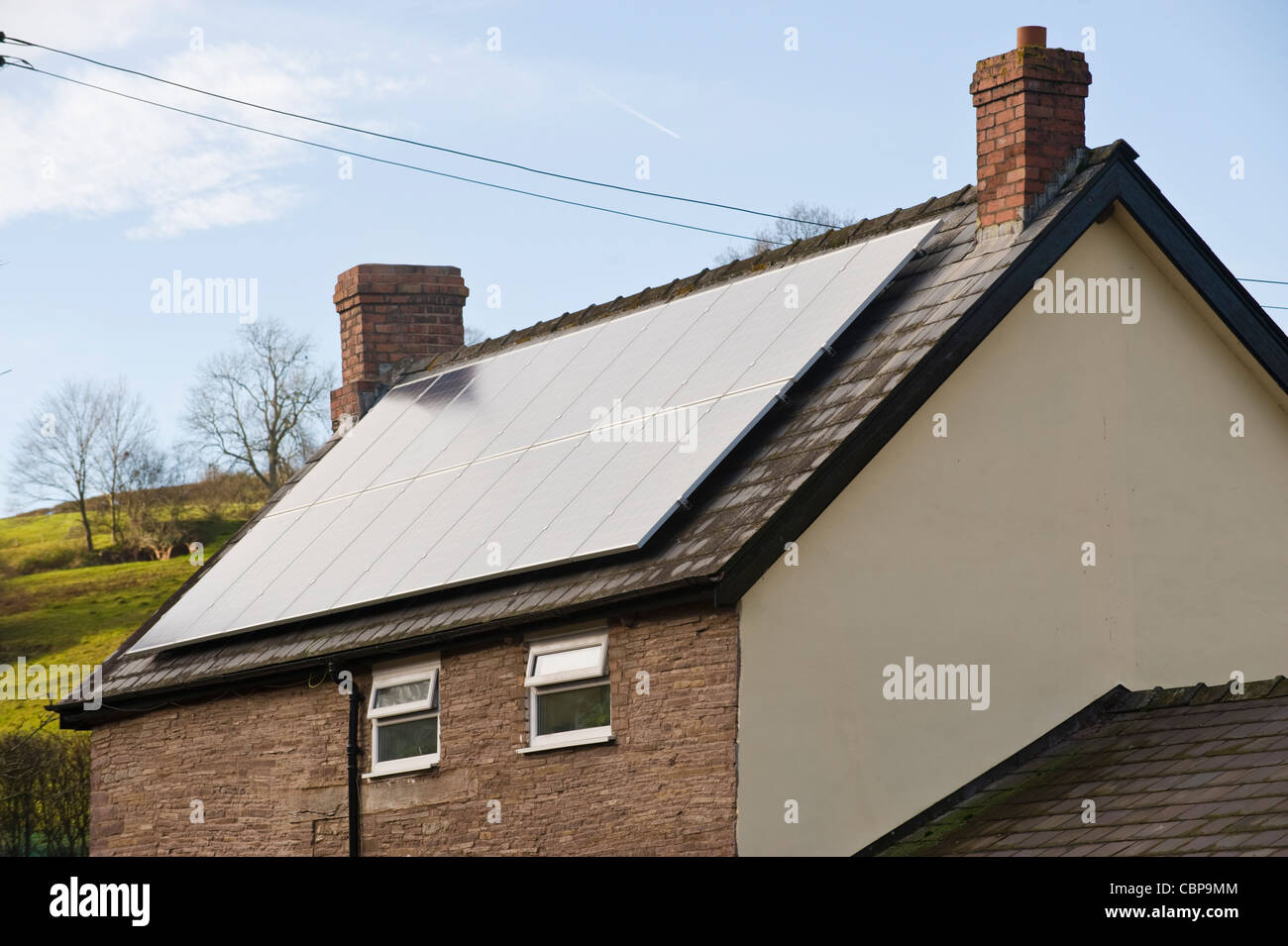 Solar panels for electricity generation on roof of rural detached house at St Margarets Herefordshire England UK - Stock Image