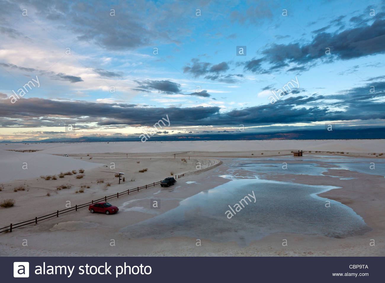 Cloudy skies and wet ground after a rainfall at White Sands National Monument, New Mexico, United States - Stock Image