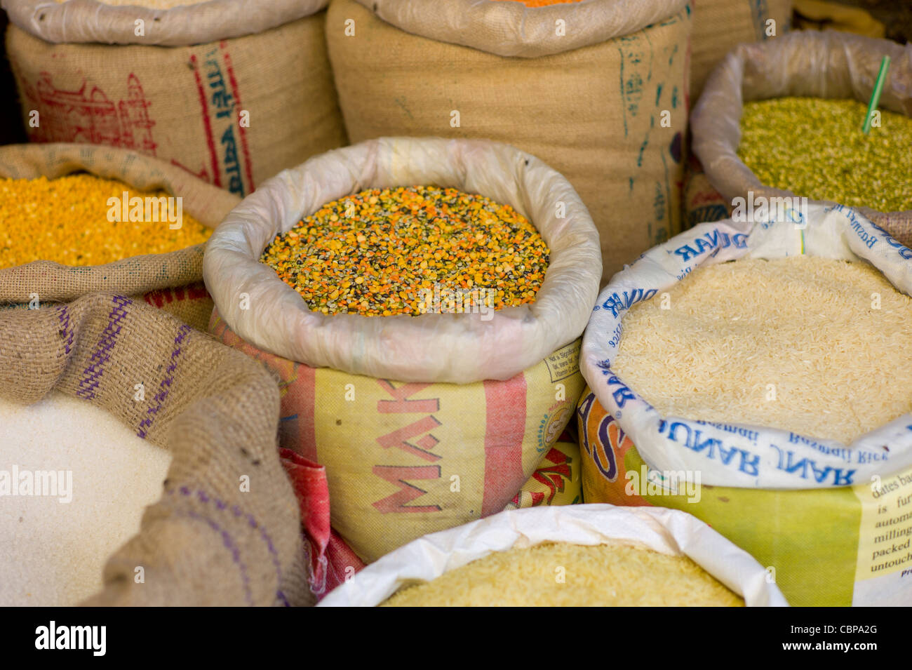 Spices and pulses including lentils and rice on sale in old town market Udaipur, Rajasthan, Western India, - Stock Image