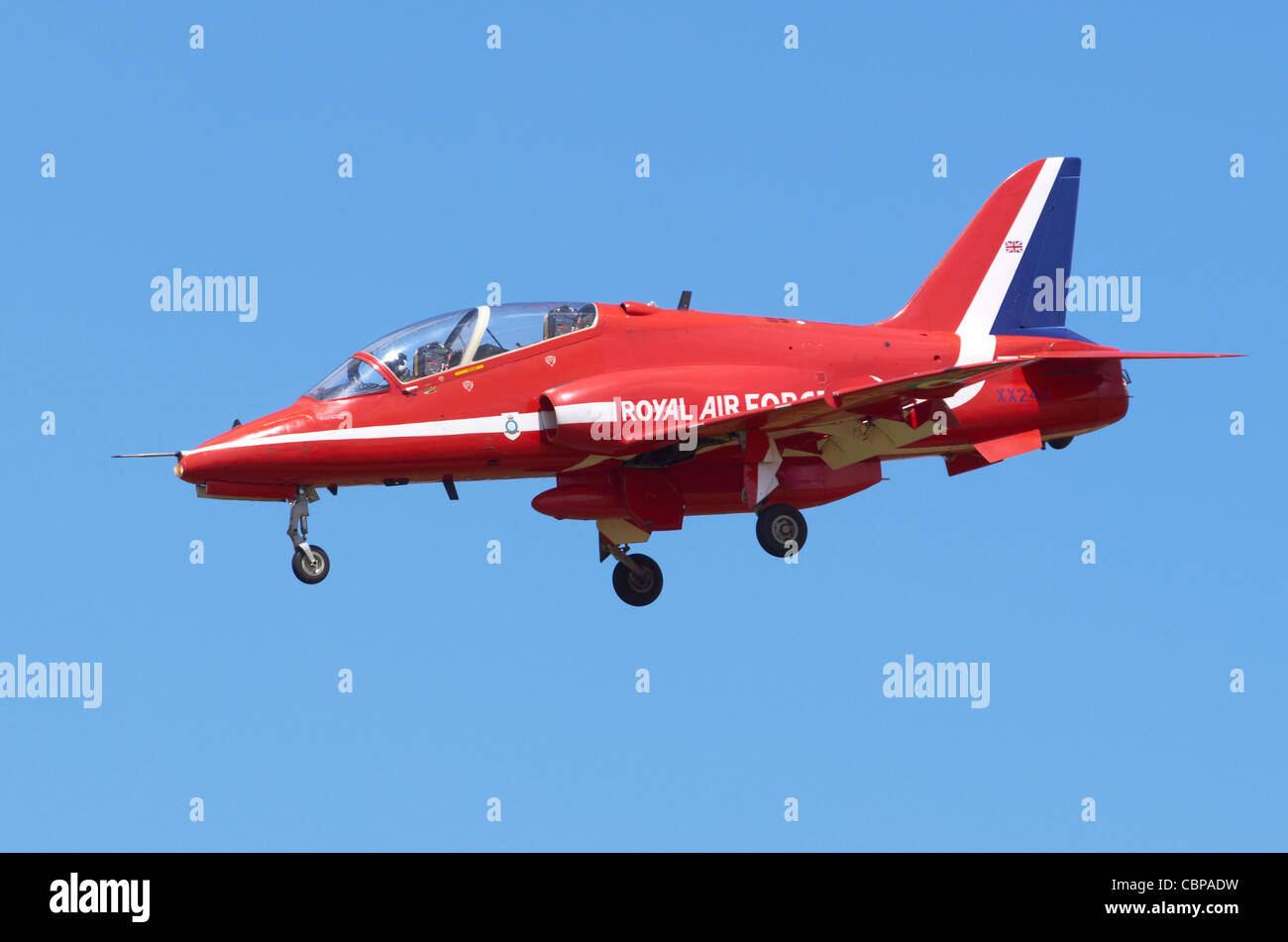 Red Arrows Hawk T1 aircraft on approach for landing at RAF Fairford, UK - Stock Image