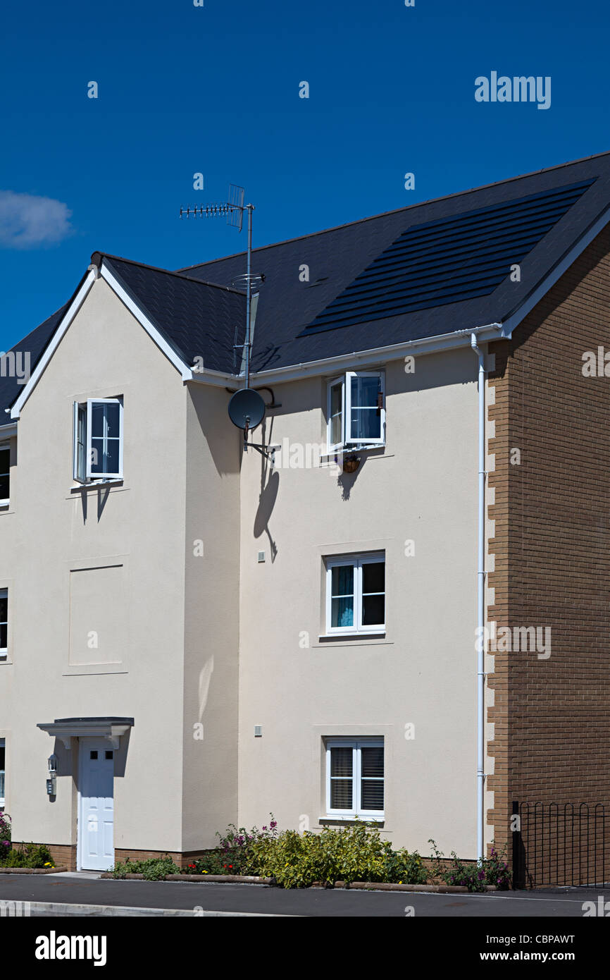 New build Barratt home on new estate with solar pv tiles integrated into roof Abergavenny Wales UK - Stock Image