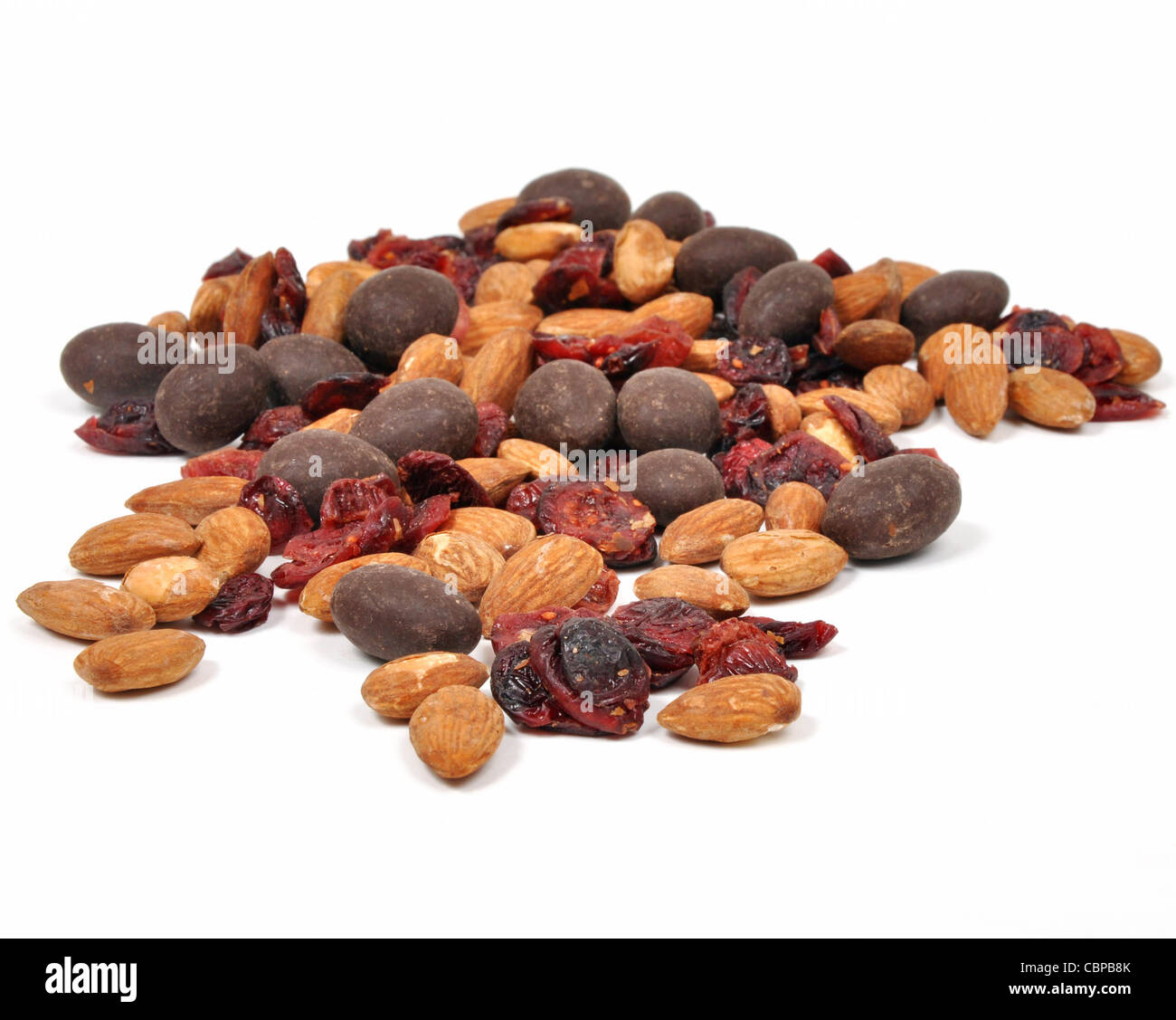 Closeup of a snack consisting of nuts, dried fruit and chocolate on a white background Stock Photo