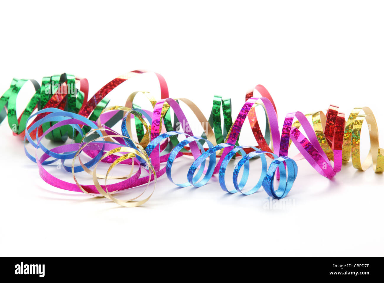 Colorful streamers on white background - Stock Image
