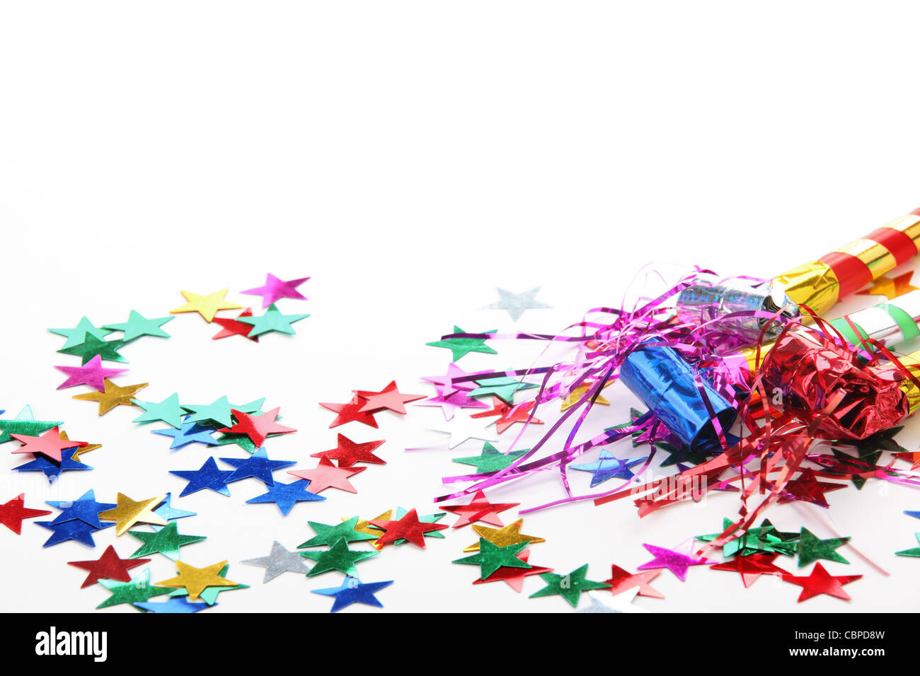 New Year's Eve noisemaker and confetti - Stock Image