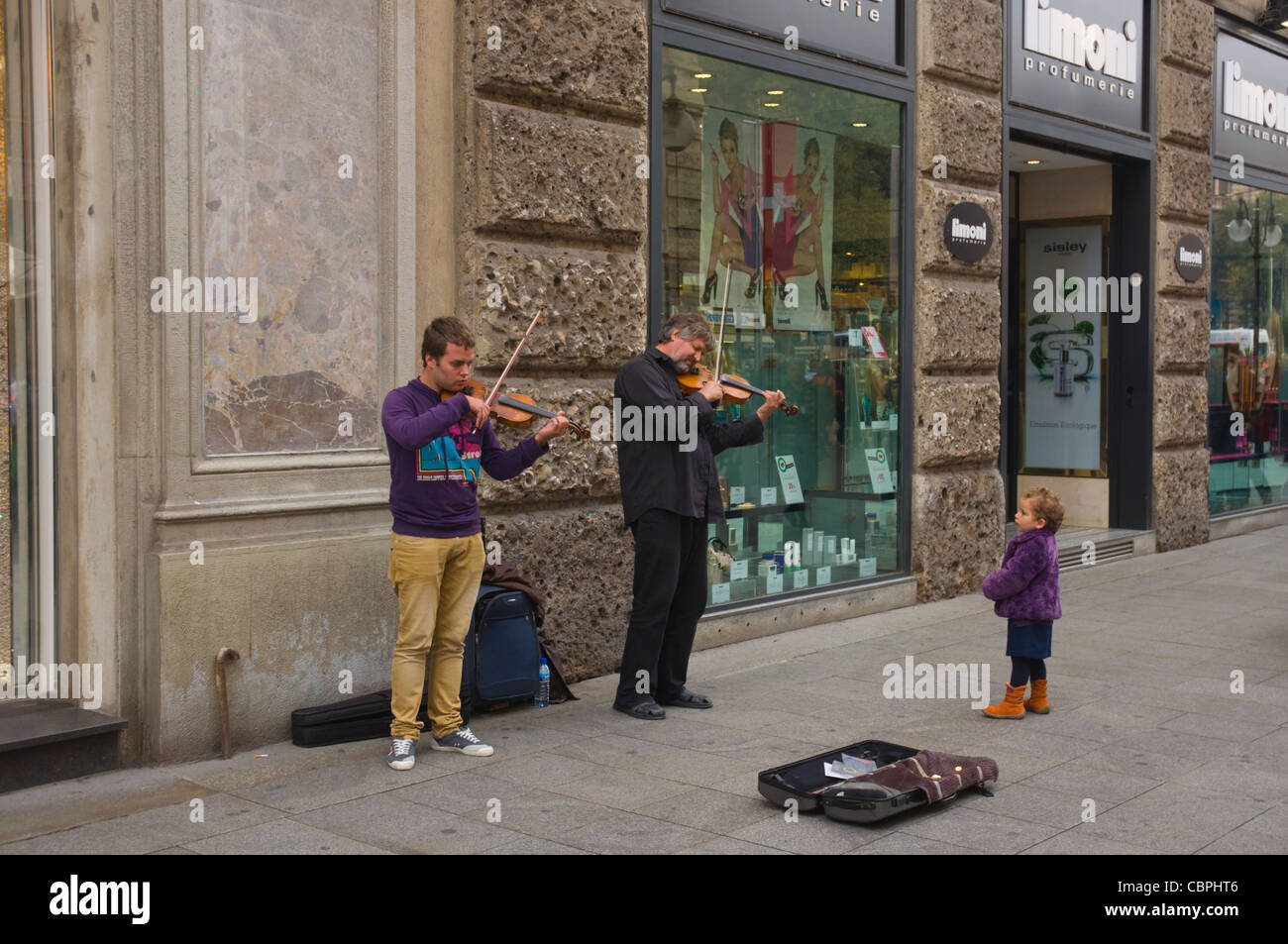 Buskers playing classical music along Via Dante street Milan Lombardy region Italy Europe - Stock Image