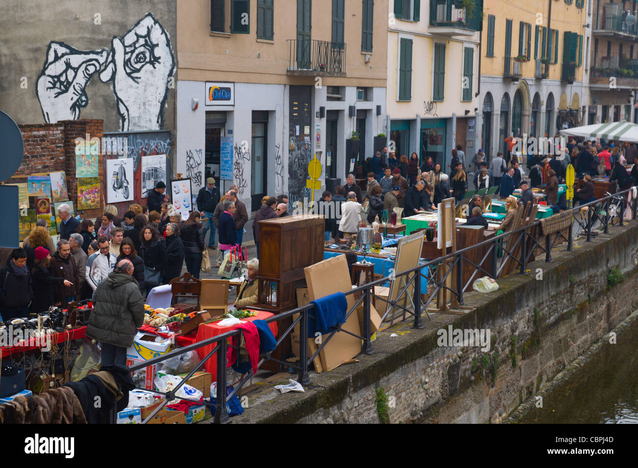 Alzaia Naviglio Grande canalside street during antiques market during last sunday of month Navigli district Milan - Stock Image
