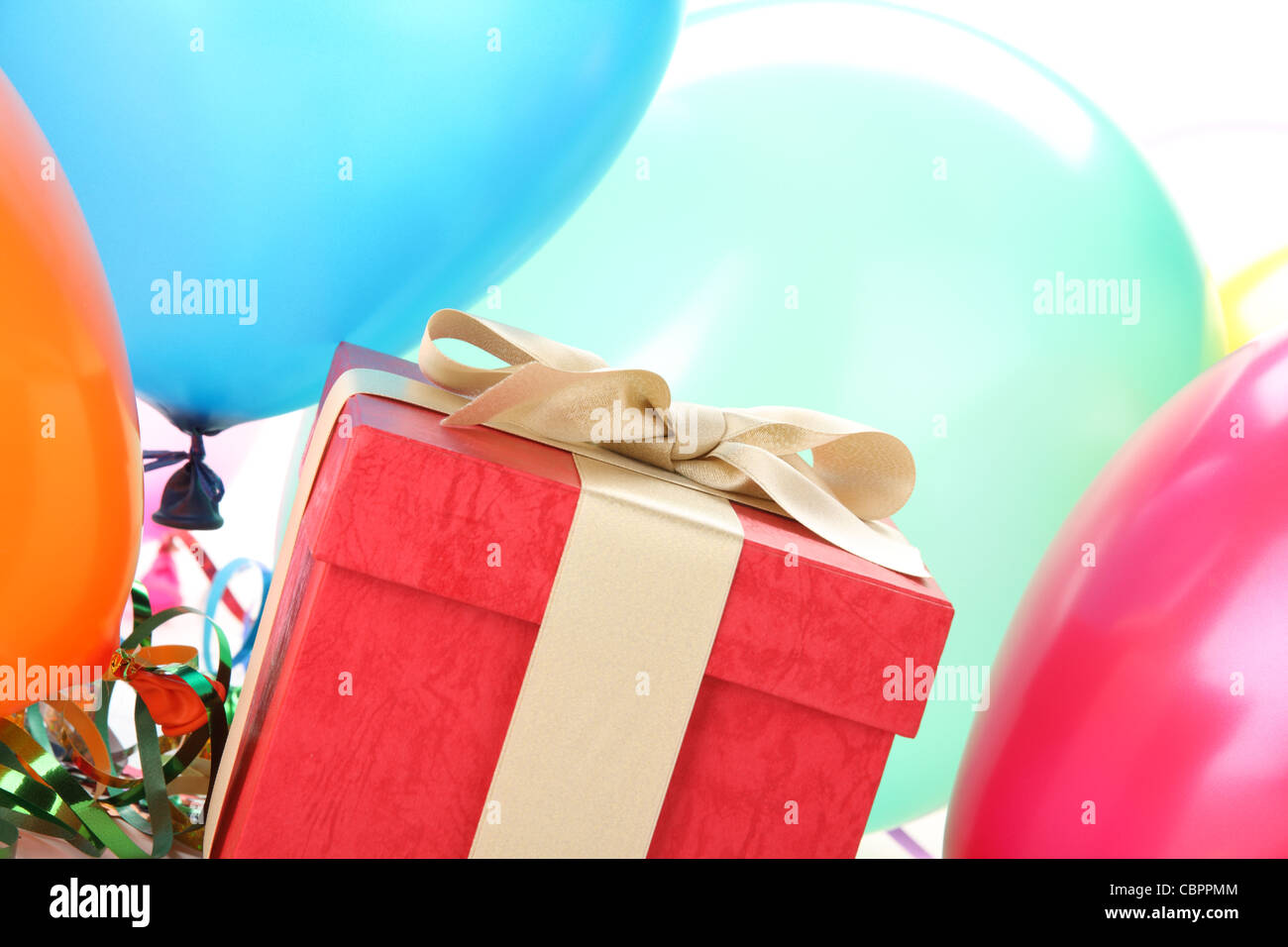 New Year's gift with balloons. - Stock Image
