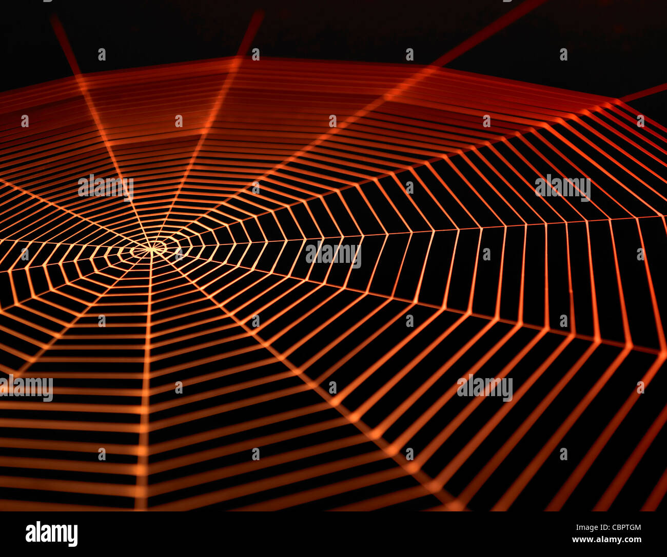 full frame symbolic picture with a painted spiderweb in dark back, orange illuminated - Stock Image