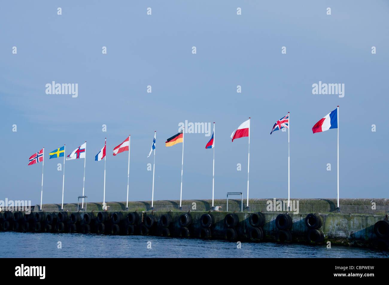 Denmark, Helsingoer. Port harbor area with EU flags. - Stock Image