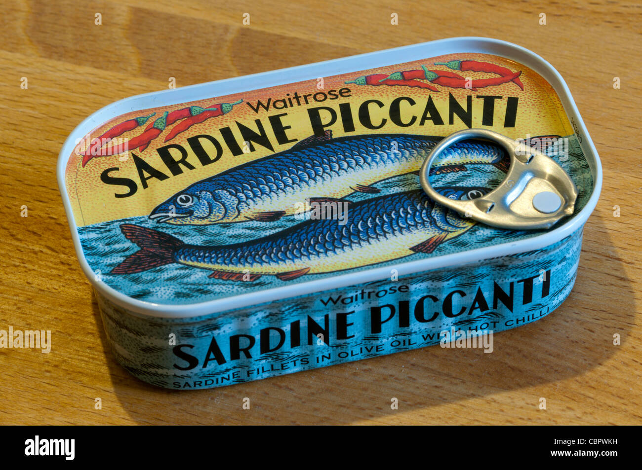 An unopened tin of Waitrose Sardine Piccanti - sardine fillets in olive oil with hot chilli. - Stock Image