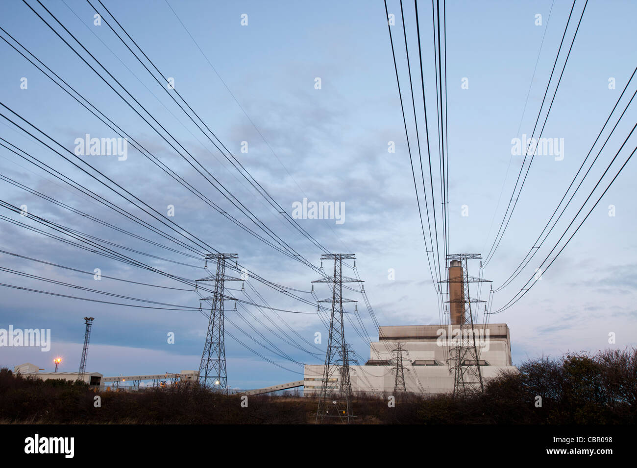 Power lines leading to an aluminium smelting plant on the outskirts of Ashington in Northumberland, UK. - Stock Image
