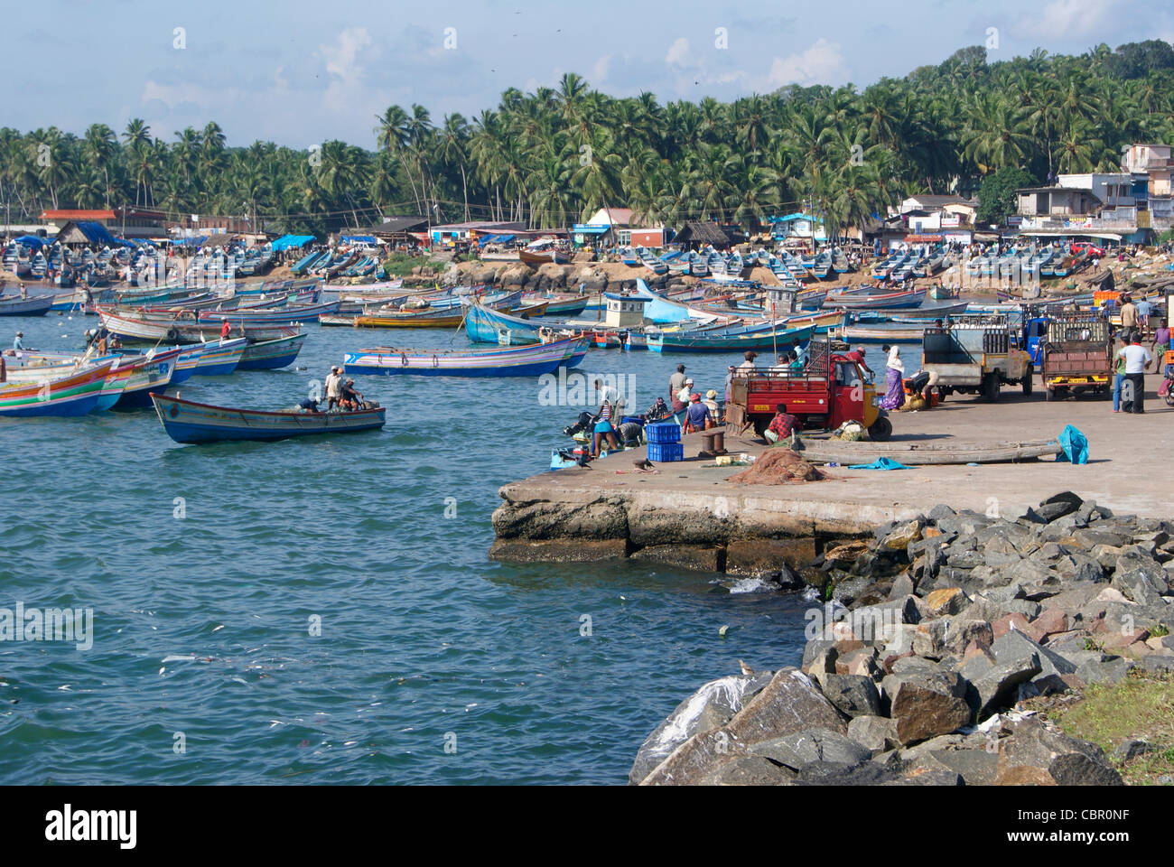 Rush full Vizhinjam Harbor in the evening.Vizhinjam Port is one of the major Fishing port of Kerala,India - Stock Image