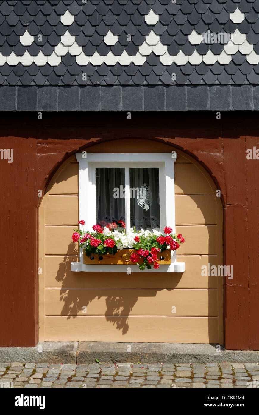 Umgebindehaus in a traditional style in the municipality of Obercunnersdorf in the Upper Lusatia in east Saxons. - Stock Image