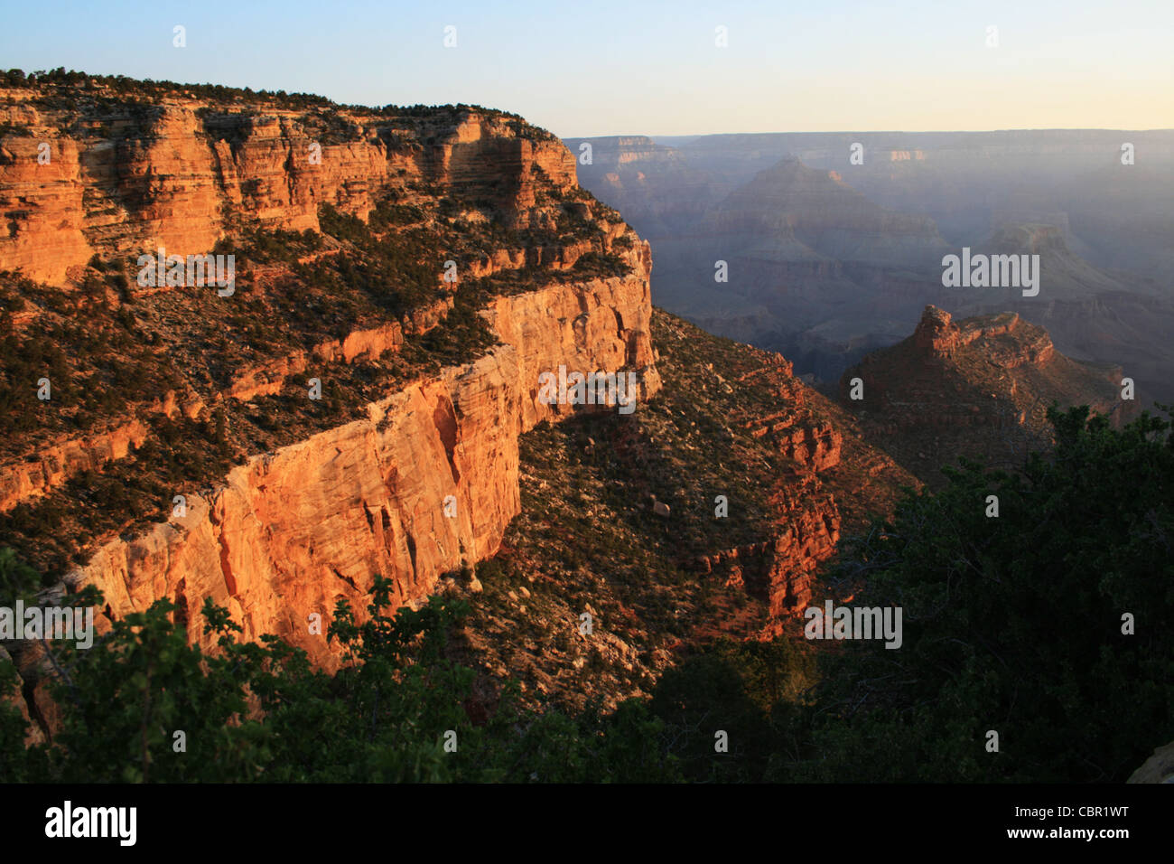 view of morning light on the Kaibab and Coconino formations from the Bright Angel Trail in the Grand Canyon - Stock Image