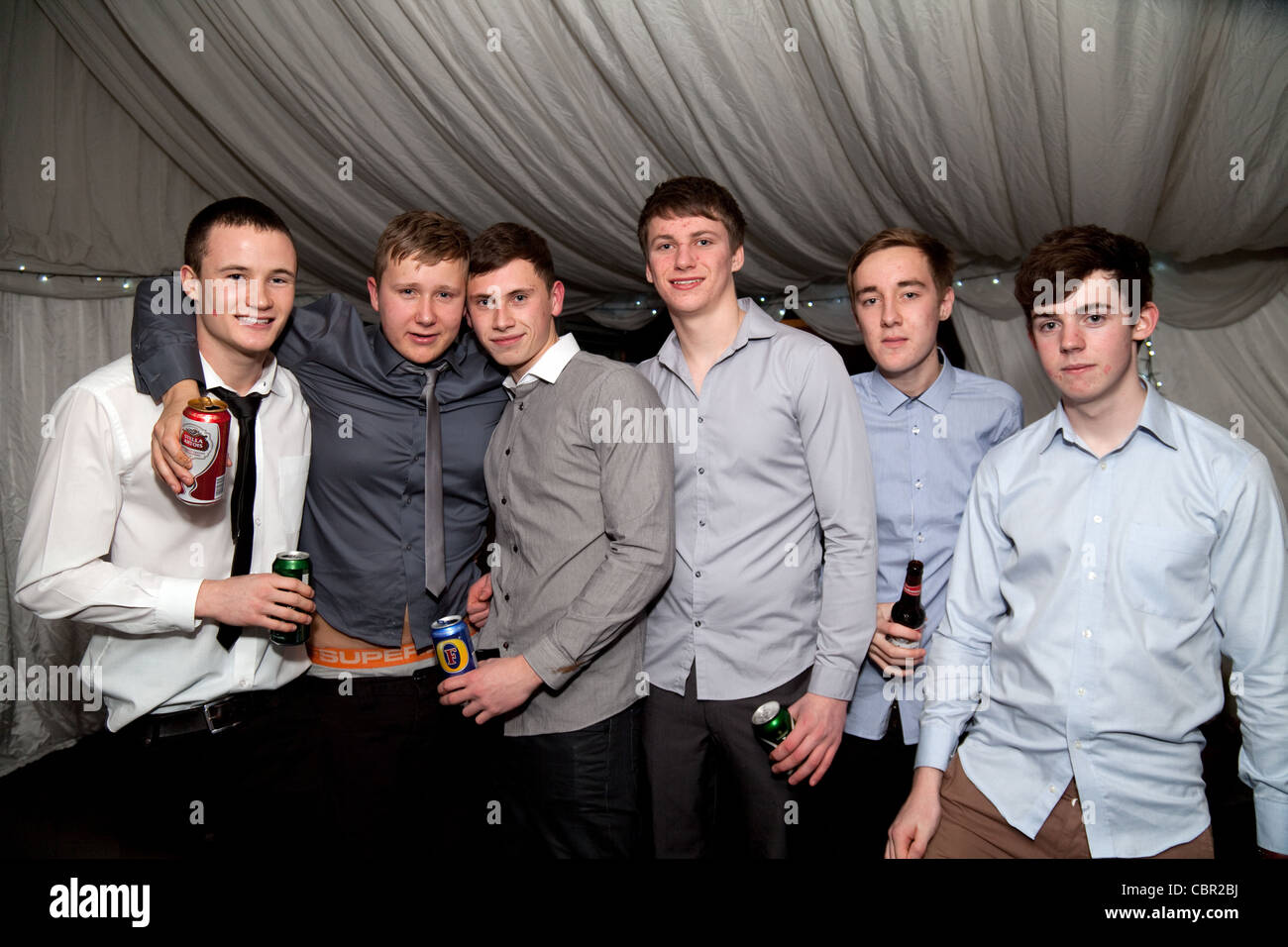 a group of teenage boys drinking beer at a party uk stock photo