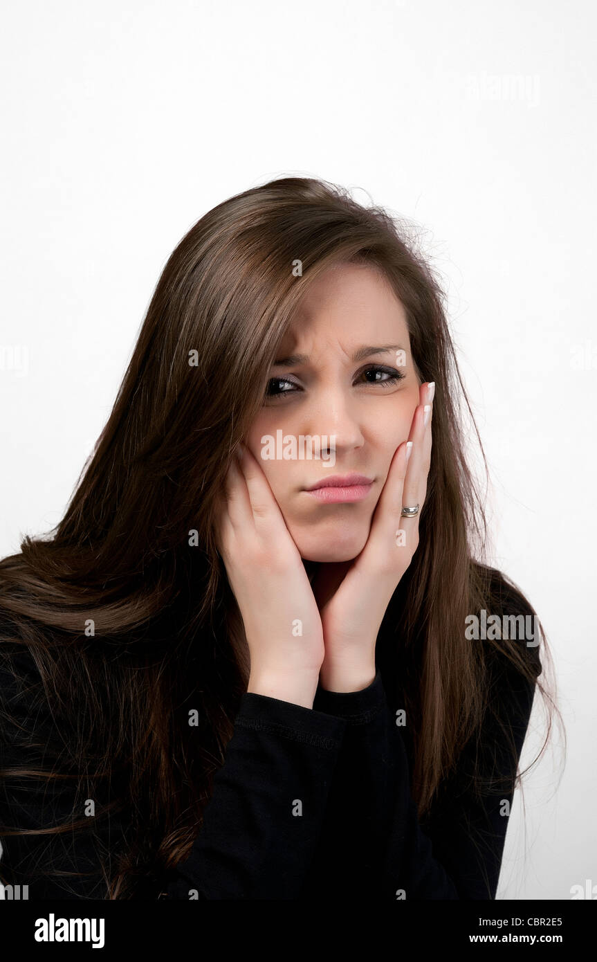 a young woman with tooth ache - Stock Image