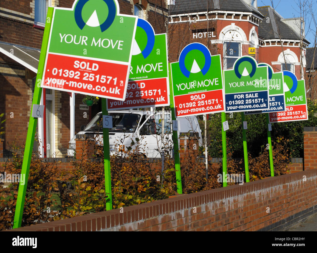 House for sale and house sold signs on a street in central Exeter UK - Stock Image