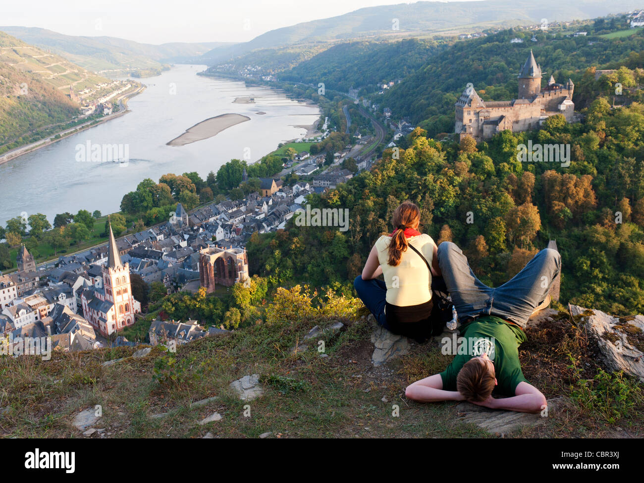 Young couple looking at scenery above Bacharach village on Romantic River Rhine in Germany - Stock Image