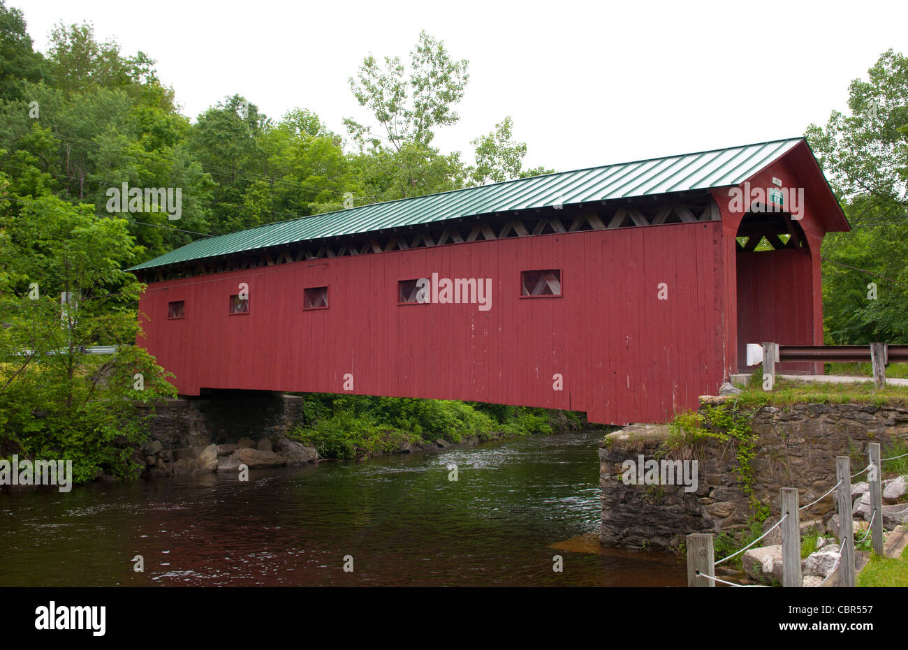 Covered Bridges of Vermont by river with rocks Depot Bridge in Pittsford VT 1840 wood wooden - Stock Image