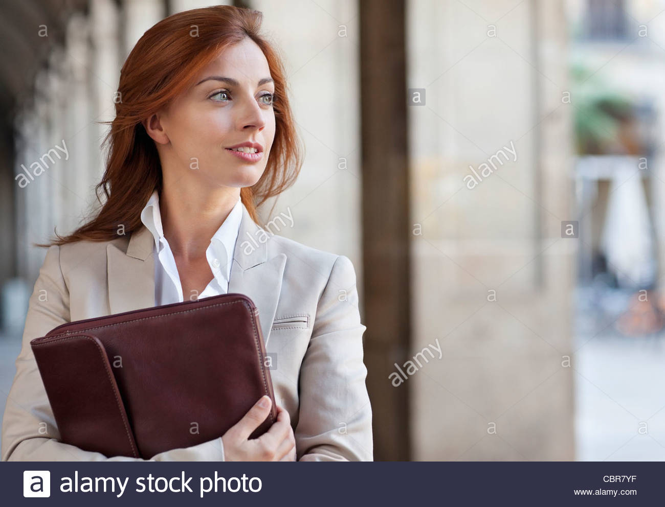 Businesswoman holding briefcase - Stock Image