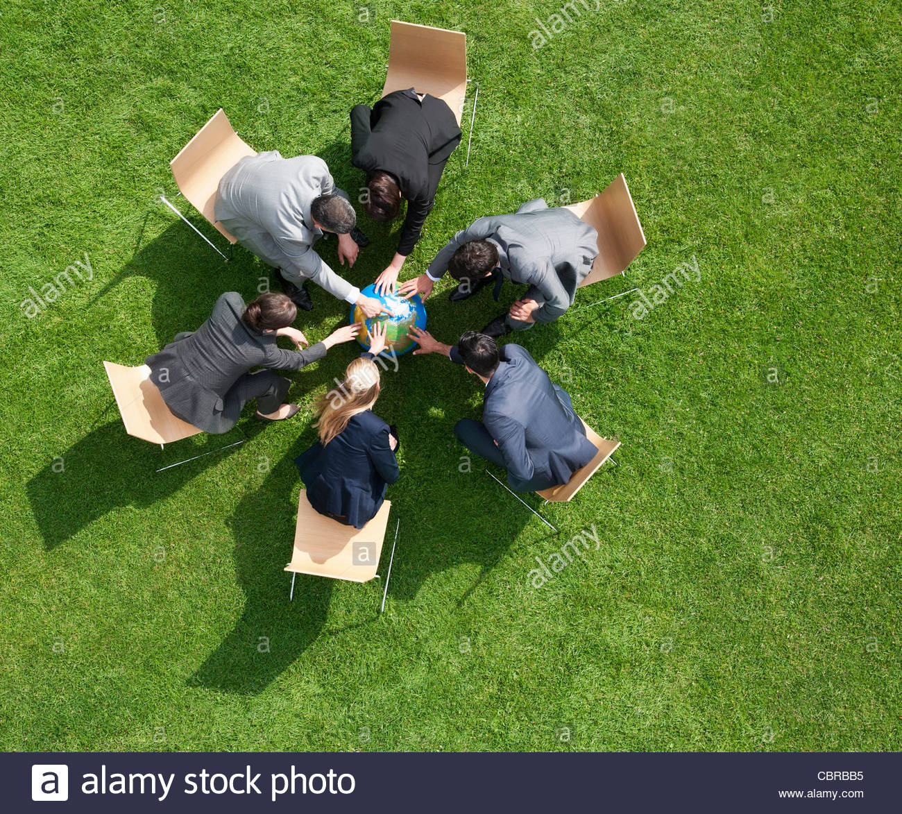 Business people working together outdoors - Stock Image