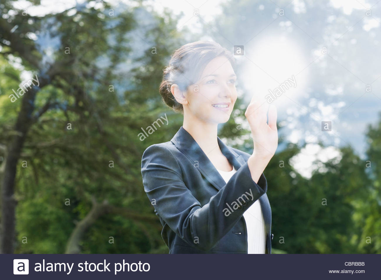 Businesswoman looking out window - Stock Image