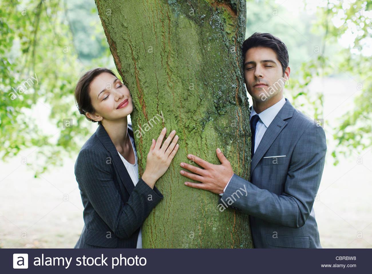 business people hugging tree stock photo 41696180 alamy