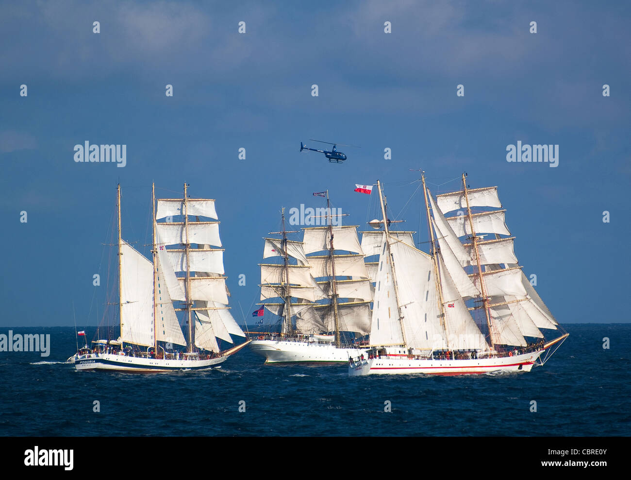 Tall ships departing Kristiansand on their way to sea for the Tall Ships race - Stock Image