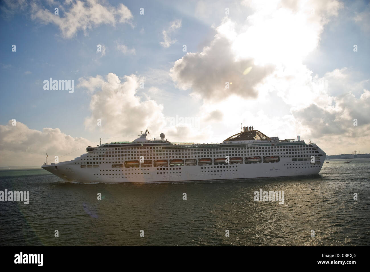 A large Cruise ship on the Solent departing Southampton Docks, Hampshire, UK - Stock Image