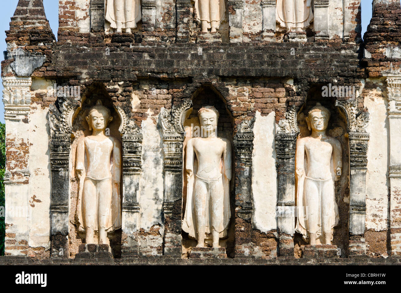 Midsection of 900 year old chedi (stupa) with standing Buddhas at Wat Chama Thewi in Lamphun in northern Thailand - Stock Image