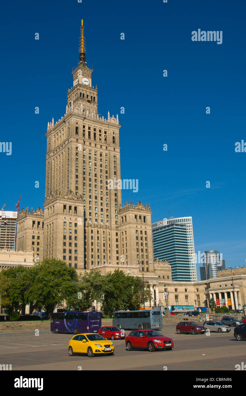 Cars parked in front of Palac Kultury i Nauki the Palace of Culture and Science at Plac Defilad square central Warsaw Stock Photo