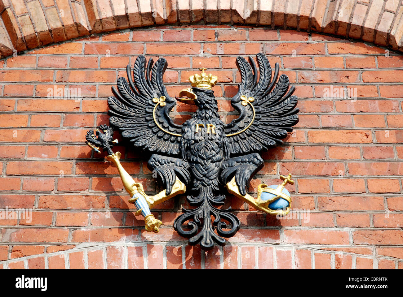 The Prussian coat of arms over the entrance of the Spandau Citadel in Berlin. - Stock Image