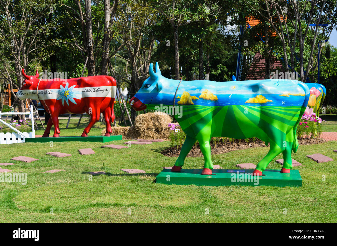 Painted cow statues with various designs at Dutch exhibit at Royal Flora Ratchaphruek in Chiang Mai Thailand - Stock Image