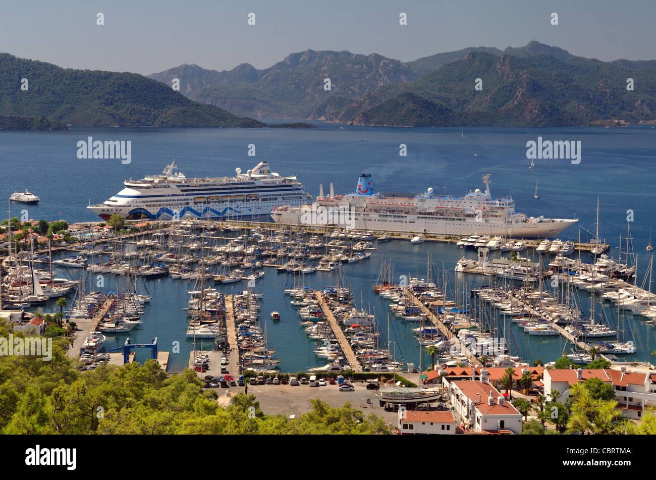 Cruise port with Thomson 'Celebration' ship on quay & Aida 'Aura' ship docking on arrival at - Stock Image