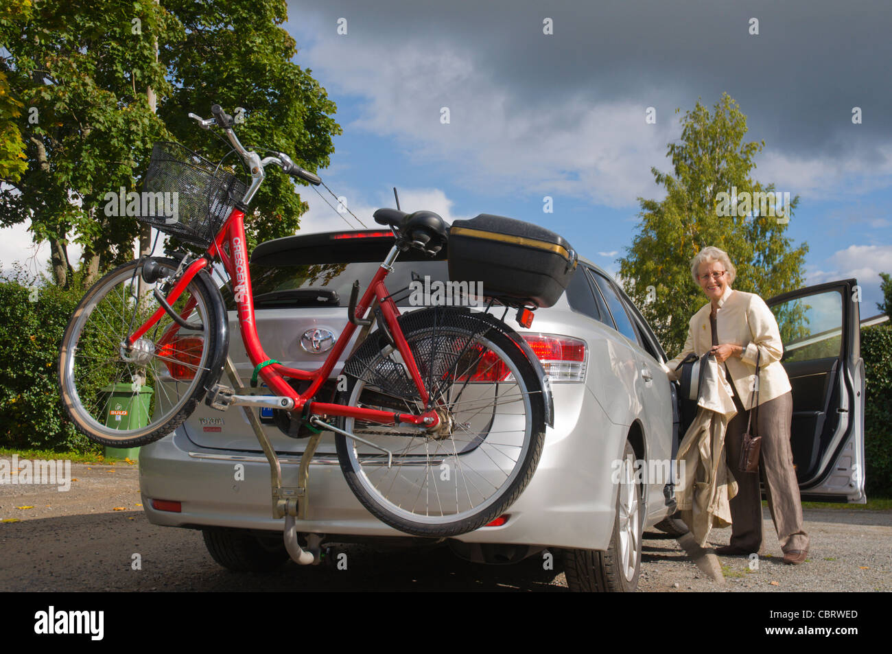 Car transporting a bicycle Finland Europe - Stock Image
