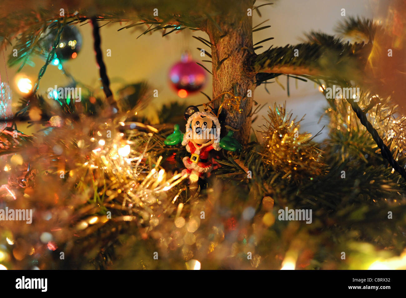 mickey mouse christmas decoration on real christmas tree photograph taken 16 december 2011
