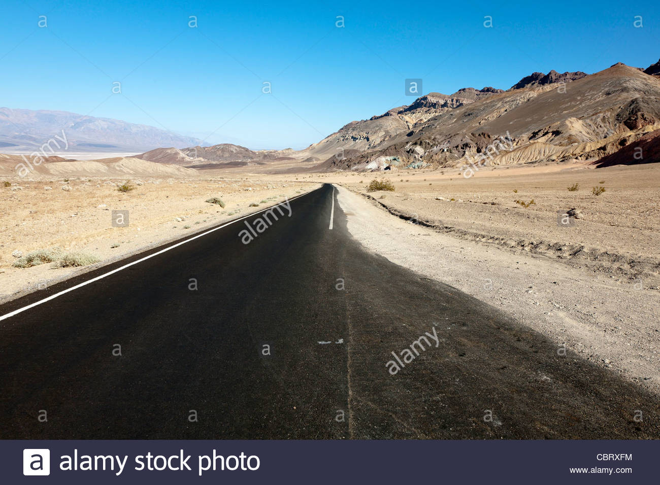 Desert Road in Death Valley National Park, California, United States - Stock Image
