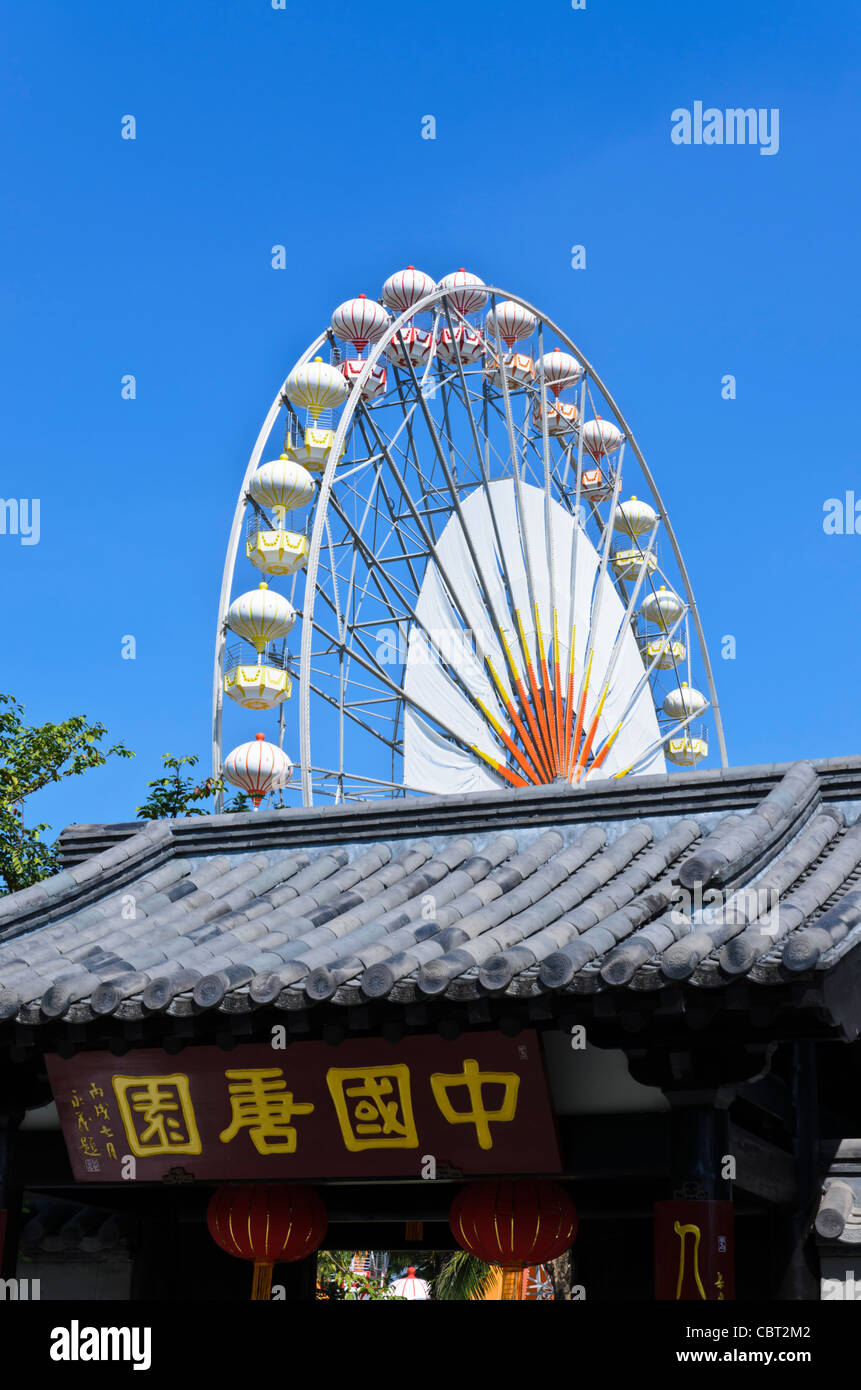 Tile rooftop of entryway at Chinese pavilion with Ferris wheel ...