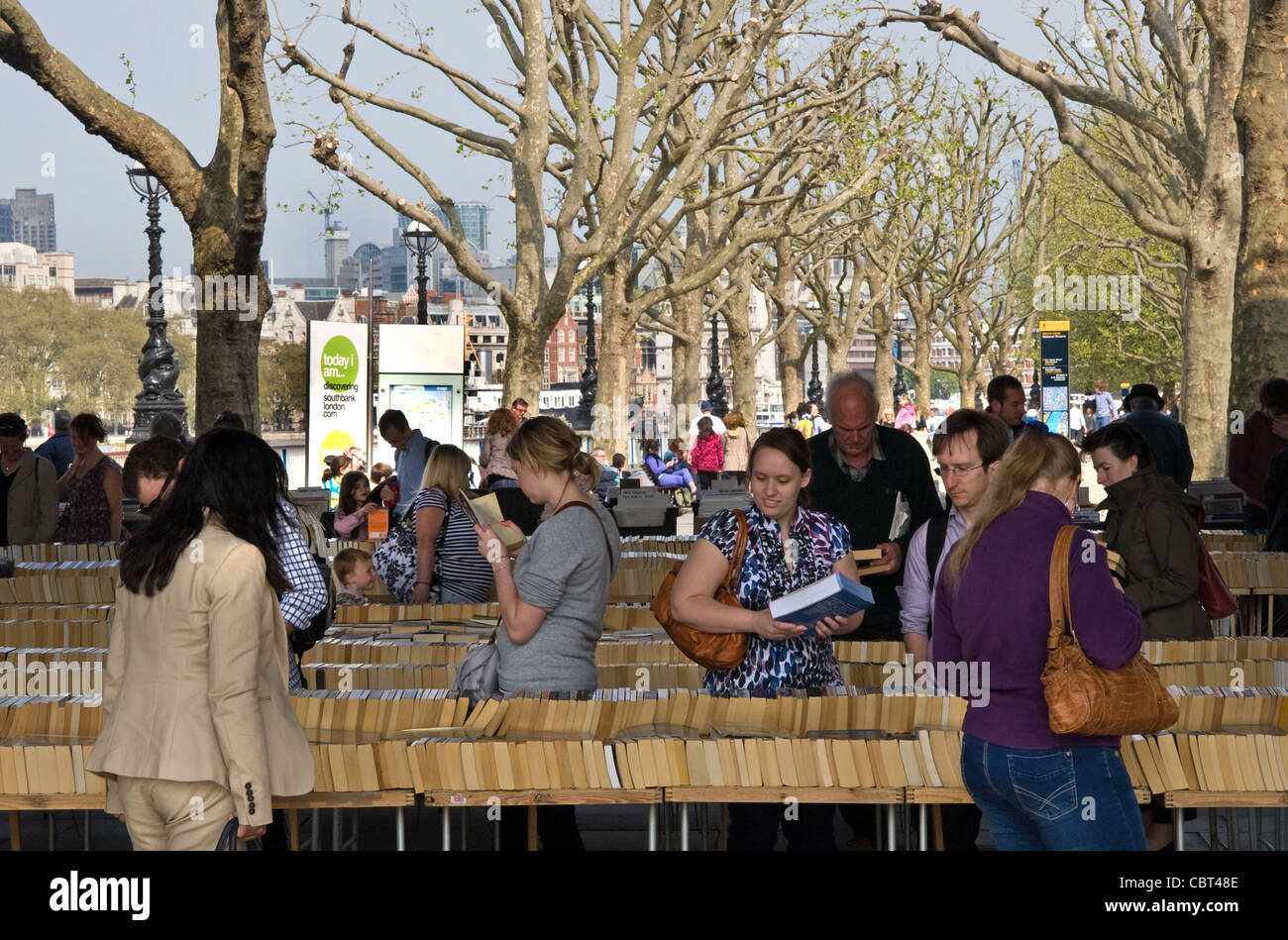 Secondhand book stalls, under Waterloo Bridge, on banks of the Thames, Southbank, London, England, UK - Stock Image