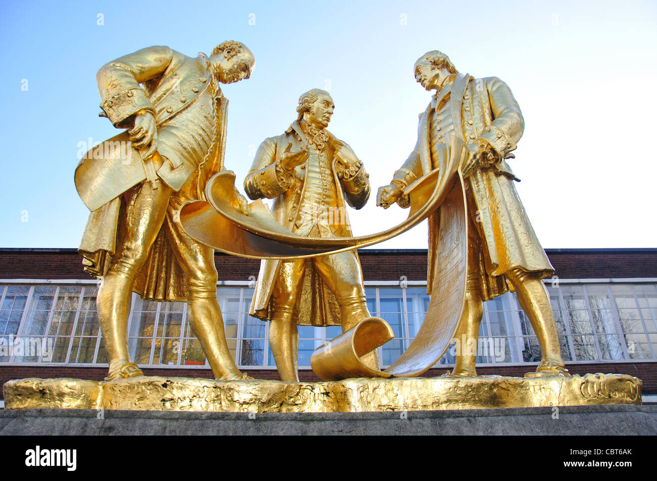 Guilded statue of Boulton, Watt and Murdoch, Broad Street, Birmingham, West Midlands, England, United Kingdom - Stock Image