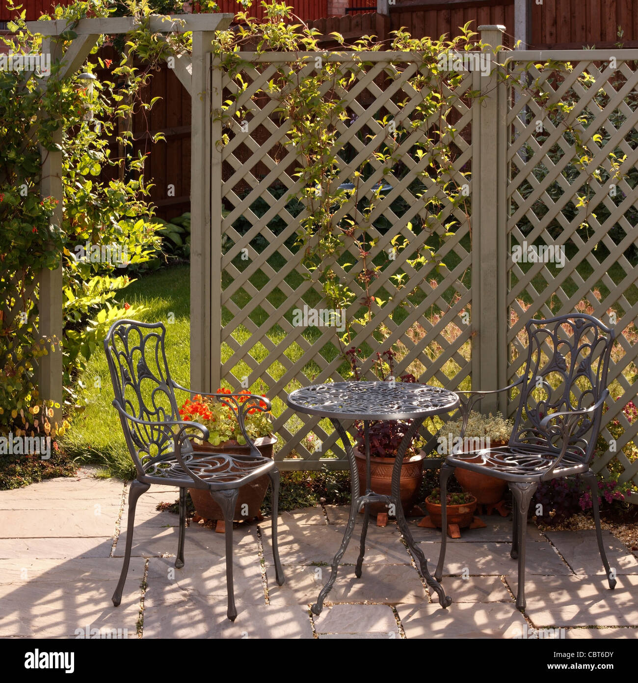 Ornate grey / green painted aluminium table and chairs with trellis ...
