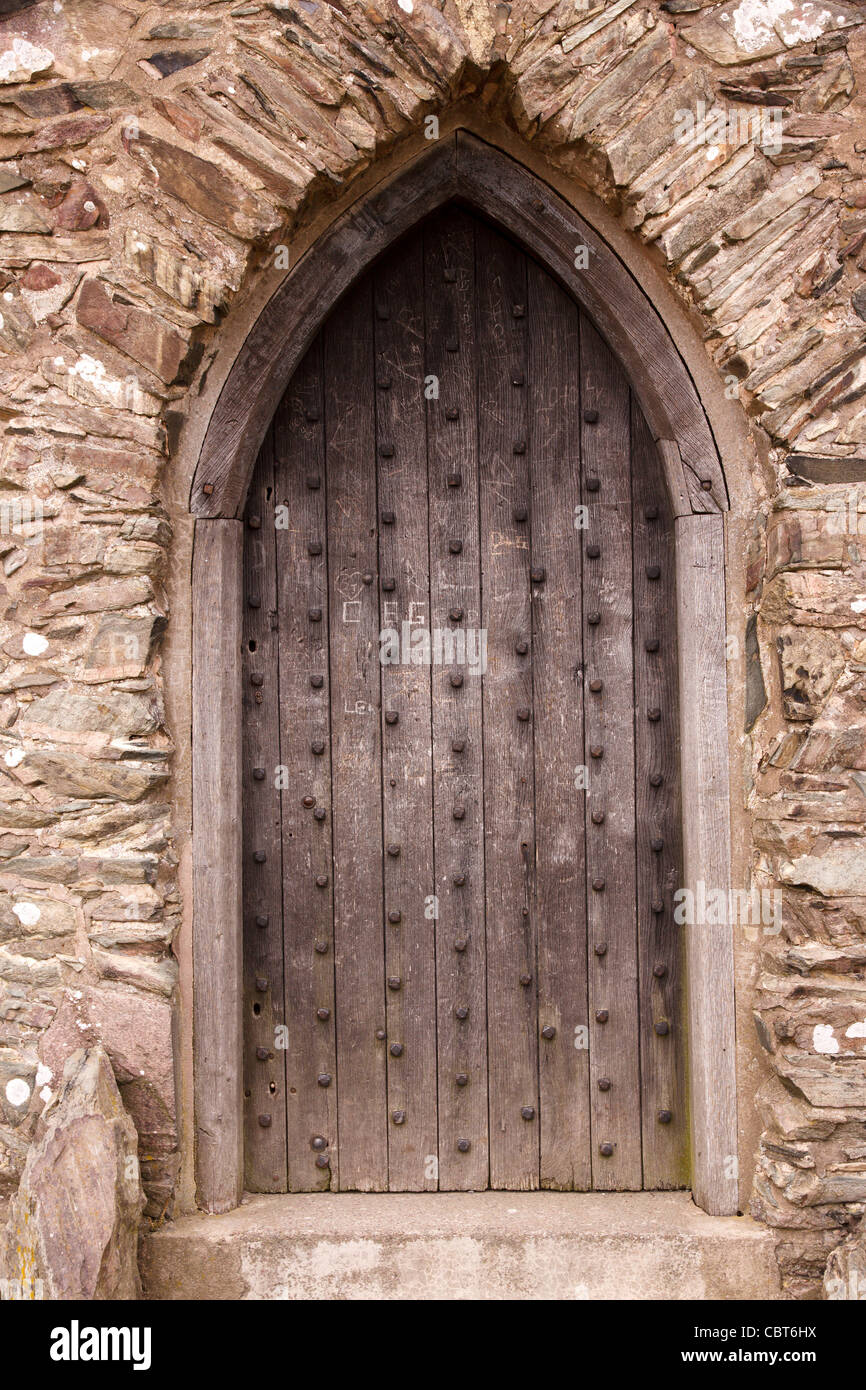 Closed old oak wooden door in pointed stone Gothic arch doorway Old John folly Bradgate Park Leicestershire England UK & Closed old oak wooden door in pointed stone Gothic arch doorway Old ...