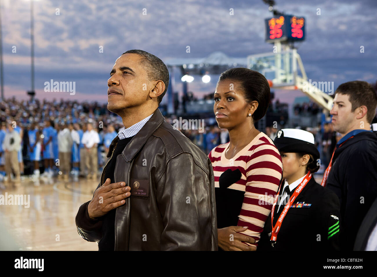 president barack obama and first lady michelle obama watch the stock